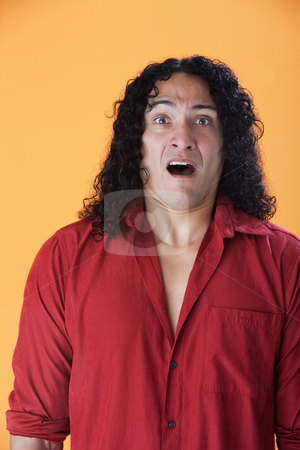 Fearful Man stock photo, Handsome man with long curly hair showing fear by Scott Griessel
