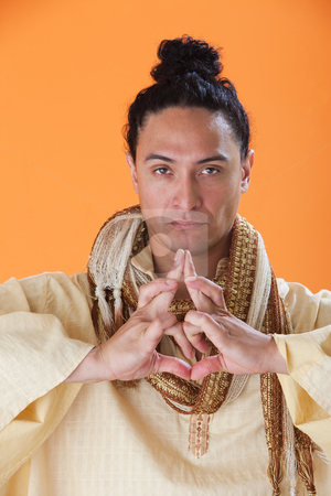 Handsome New Age Guru stock photo, Handsome New Age Guru Making a Strange Symbol with his hands by Scott Griessel