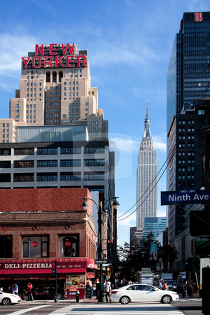 New York street scene stock photo, New York City Manhattan 34th street scene with the landmark New Yorker Hotel and Empire State building. by Paul Hakimata