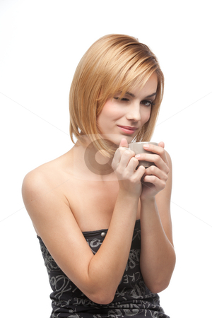 Woman holding a coffee cup stock photo, A side portrait of a young, blonde woman, holding a coffee cup with both her hands, and giving a wink by dan comaniciu