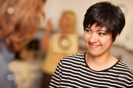 Smiling Young Woman Socializing stock photo, Smiling Young Woman Socializing in a Party Setting. by Andy Dean