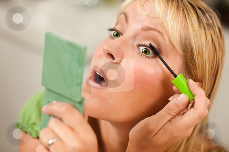 Blonde Woman Applying Her Mascara stock photo, Blonde Woman Applying Her Mascara Makeup in Her Bathroom. by Andy Dean