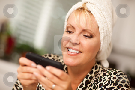 Attractive Woman Texting With Her Cell Phone stock photo, Attractive Woman Texting With Her Cell Phone with Narrow Depth of Field. by Andy Dean