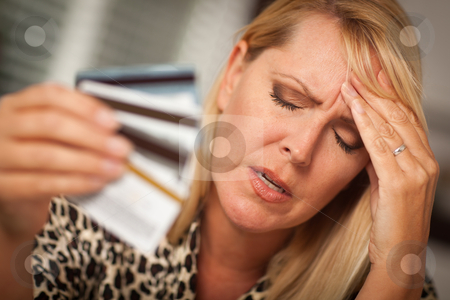 Upset Woman Holding Her Many Credit Cards stock photo, Very Upset Woman Holding Her Many Credit Cards. by Andy Dean