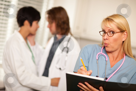 Alarmed Medical Woman Witnesses Colleagues Inner Office Romance stock photo, Alarmed Medical Woman Witnesses Her Colleagues Inner Office Romance Display. by Andy Dean