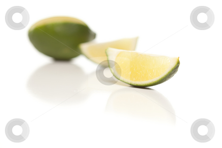 Sliced Lime on Reflective White Surface stock photo, Sliced Lime on a Reflective White Surface. by Andy Dean