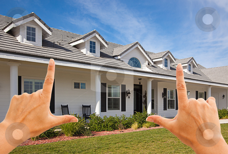 Female Hands Framing Beautiful House stock photo, Female Hands Framing Beautiful House Over Blue Sky. by Andy Dean