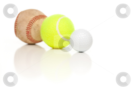 Baseball, Tennis and Golf Ball on White stock photo, Baseball, Tennis and Golf Ball Isolated on a White Reflective Background. by Andy Dean