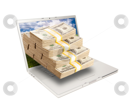 Laptop with Stacks of Money Coming From Screen stock photo, Silver Computer Laptop Isolated on White with Stacks of Hundred Dollar Bills Extruding the Screen. by Andy Dean