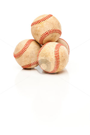 Four Baseballs Isolated on Reflective White stock photo, Four Baseballs Isolated on a Reflective White Background. by Andy Dean