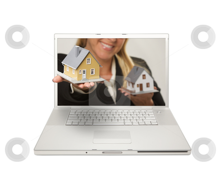Woman Handing House Through Laptop Screen stock photo, Woman Handing House Through Laptop Screen Isolated on a White  Background. by Andy Dean