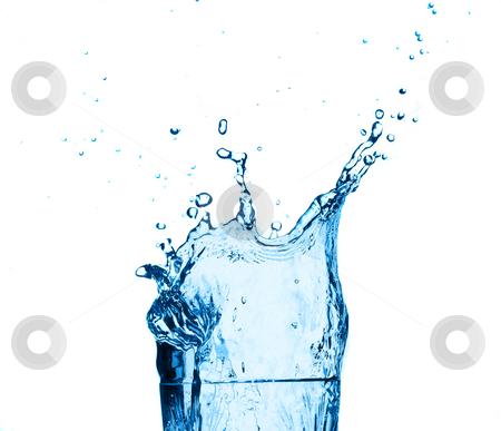 Blue water splashing on glass,white background. stock photo, Blue water splashing in a glass, isolated on white background. by Pablo Caridad