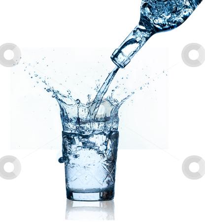 Blue water splashing on glass, white background. stock photo, Blue water splashing on glass, isolated on white background. by Pablo Caridad