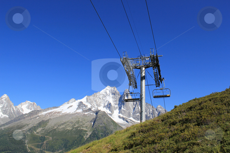 Chair lifts  in front of the Mont-Blanc massif, France stock photo, Chair lifts in the mountain in front of the Mont-Blanc massif, France by Elenaphotos21
