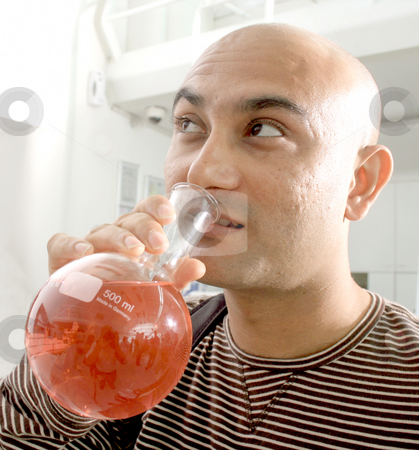 Potty professor or the crazy chemist stock photo, The mad chemist being his own guinea pig by Kantilal Patel