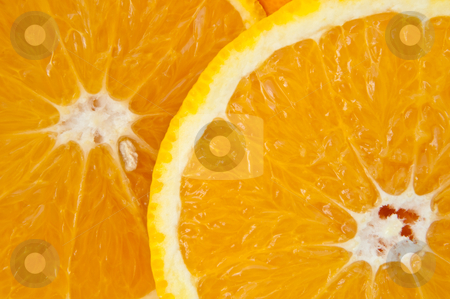 Sunshine orange. stock photo, Close up of two fresh orange slices. by Samantha Craddock