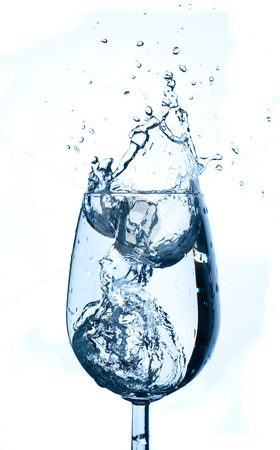 Water splash in glass stock photo, Water splash in glass isolated on white background. by Pablo Caridad