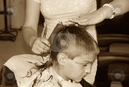 Boy  haircut stock photo, Caucasian boy getting a haircut sepia tones by Julija Sapic