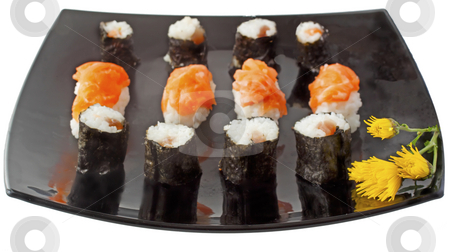 Sushi stock photo, Pieces of sushi over a black plate with yellow flower by Fabio Alcini