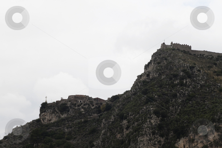 Hill Side Church stock photo, Two Churches looking over the overcast hills of Messina, Italy by Kevin Tietz