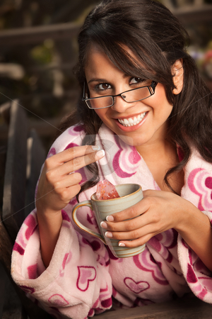Pretty Hispanic Woman in Bathrobe with Tea stock photo, Pretty Hispanic Woman in Bathrobe Sitting Outdoors with Tea by Scott Griessel