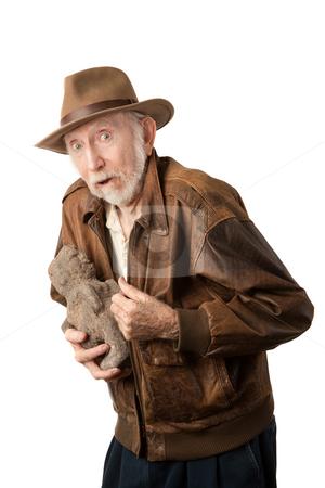 Adventurer or archaeologist with stolen idol stock photo, Adventurer or archaeologist in brown leather jacket with stolen idol by Scott Griessel