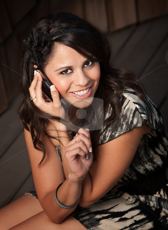 Beautiful Latina Woman on Cell Phone stock photo, Beautiful Latina Woman Talking on her Cell Phone by Scott Griessel