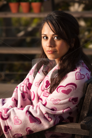 Pretty Hispanic Woman in Bathrobe stock photo, Pretty Hispanic Woman in Bathrobe Sitting Outdoors by Scott Griessel
