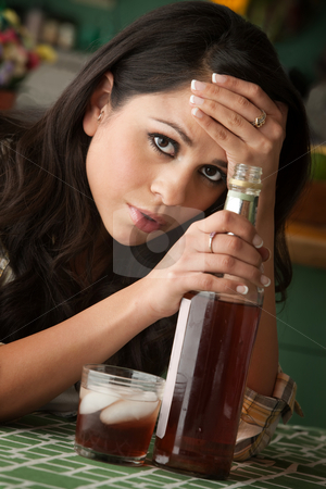 Alcoholic Latina Woman stock photo, Alcoholic Latina Woman at Home with Liquor Bottle by Scott Griessel