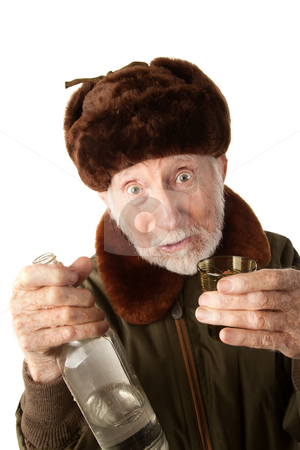 Russian Man in Fur Cap with Vodka stock photo, Senior Russian Man in Fur Cap and Jacket with Vodka by Scott Griessel