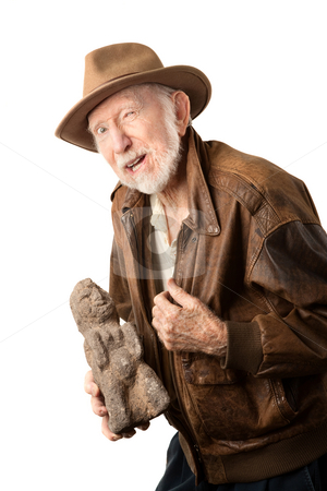 Adventurer or archaeologist offering to sell idol stock photo, Adventurer or archaeologist in brown leather jacket offering to sell  idol by Scott Griessel