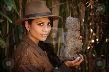 Pretty adventurer with relic stock photo, Pretty adventurer with relic in thick green bamboo forest by Scott Griessel