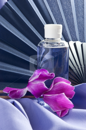 fan ,flowers and scented oil  stock photo, fan ,flowers and scented oil on fabric and purple fan by @ Photofollies by Carla Zagni