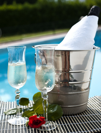 Pool 15 stock photo, Iced drinks placed on board a private pool. by @ Photofollies by Carla Zagni