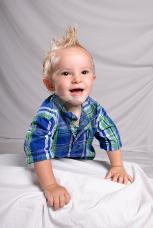 Toddler Punk stock photo, Portrait of a toddler boy with spiked hair, looking happy and smiling by Richard Nelson