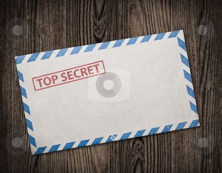 Old top secret envelope on table. stock photo, Open  envelope with top secret stamp, on wooden table, clipping path. by Pablo Caridad