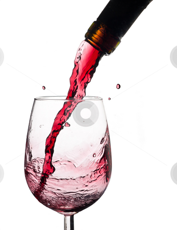 Wine splash on glass. stock photo, Wine splash on a glass, white background. by Pablo Caridad