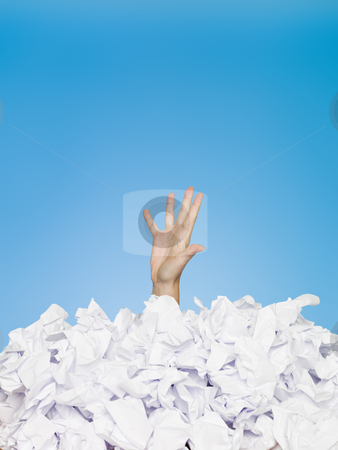 Buried Human stock photo, Human hand buried in papers by Anne-Louise Quarfoth