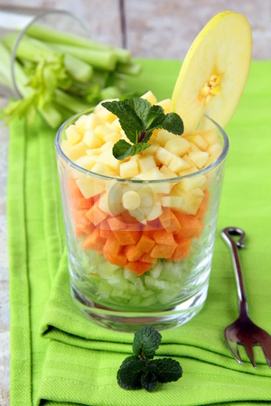 Salad of celery and apple  stock photo, Salad of celery and apple and carrot in a glass lined coats by Olga Kriger