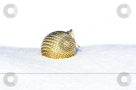 White december stock photo, Golden christmas bauble in snow by Viktor Thaut