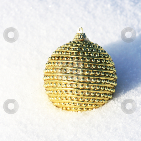 Merry christmas card stock photo, Golden christmas bauble in snow by Viktor Thaut