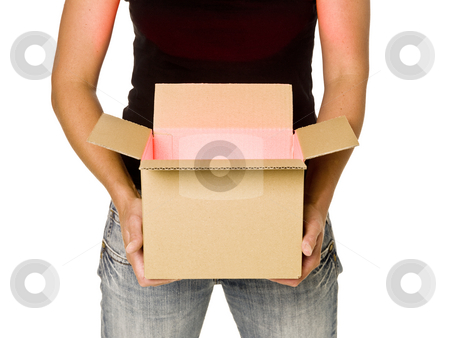 Woman holding a cardboard box stock photo, Woman holding a heavy cardboard box isolated on white background by Anne-Louise Quarfoth