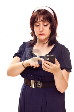 Reluctant Young Caucasian Woman Texting On Mobile Phone stock photo, Reluctant Young Caucasian Woman Pushing Button on Her Mobile Phone. by Andy Dean