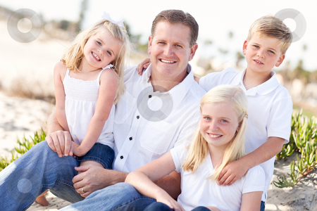 Handsome Dad and His Cute Children at The Beach stock photo, Handsome Dad and His Cute Children Portrait at The Beach. by Andy Dean