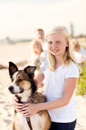 Cure Girl Playing with Her Dog Outside stock photo, Cure Girl Playing with Her Dog at the Beach. by Andy Dean