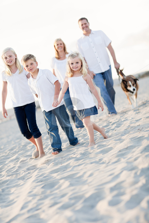 Adorable Little Girl Leads Her Family on a Walk stock photo, Adorable Little Girl Leads Her Family on a Walk at the Beach. by Andy Dean