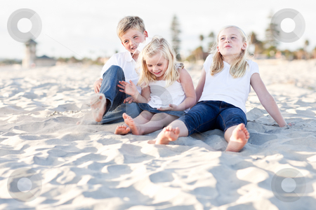 Adorable Sisters and Brother Having Fun at the Beach stock photo, Adorable Sisters and Brother Having A Lot Fun at the Beach. by Andy Dean