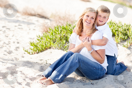 Cute Son Hugs His Mom at The Beach stock photo, Cute Son Hugs His Attractive Mom Portrait at The Beach. by Andy Dean