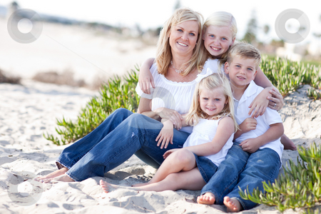 Attractive Mom and Her Cute Children at The Beach stock photo, Attractive Mom Portrait with Her Cute Children at The Beach. by Andy Dean
