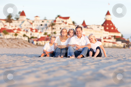 Happy Caucasian Family in Front of Hotel Del Coronado stock photo, Happy Caucasian Family in Front of Hotel Del Coronado on a Sunny Afternoon. by Andy Dean